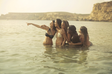 Girls on vacation at the sea photo
