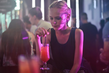 Girl drinking in a dance club