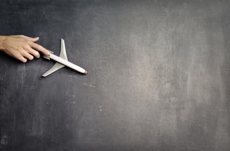 A toy plane on a blackboard 写真素材