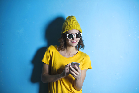 Happy girl with a smartphone Archivio Fotografico - 94735739