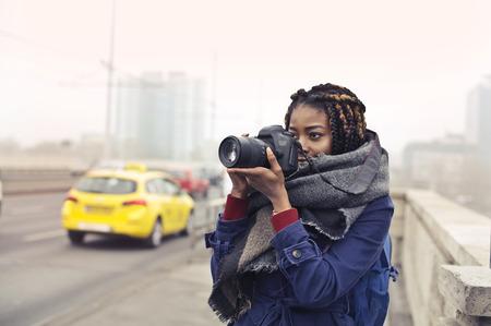Girl taking a photo on a bridge