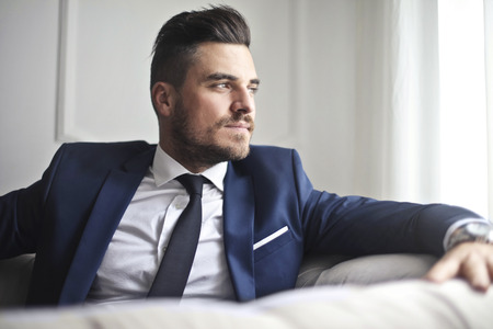 Elegant man on a sofa Stock Photo - 94736092