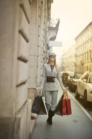 Girl with some shopping bags in a city street