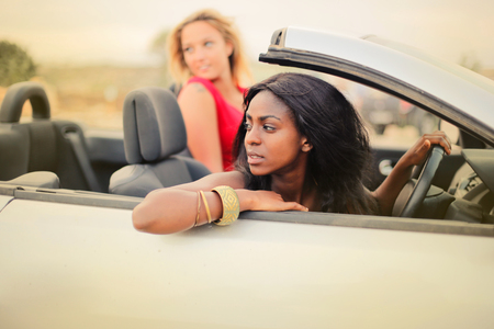 Two girls in a sports car