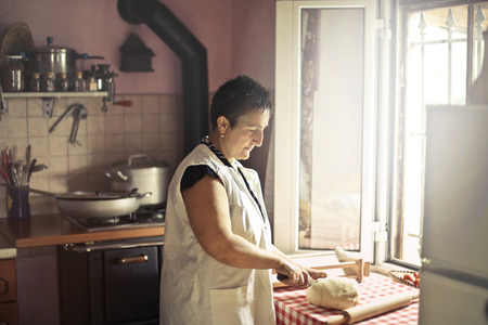 Woman cooking in a country kitchen