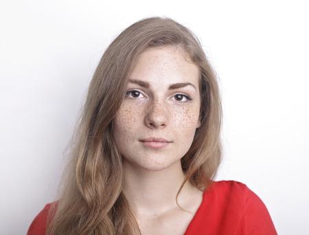 Portrait of a girl with freckles Foto de archivo