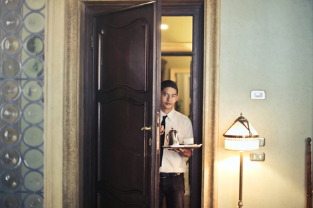 Waiter entering a room with a cabaret Archivio Fotografico - 94856555