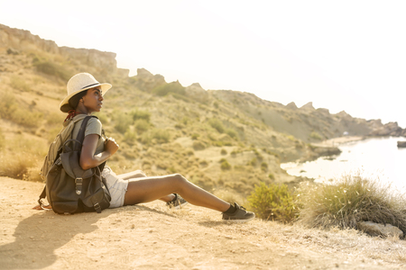 Girl on holiday in a natural context Stock Photo