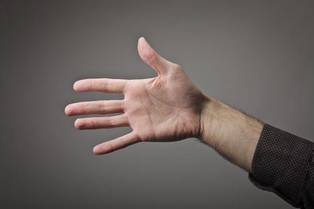 Een detail van een open hand
