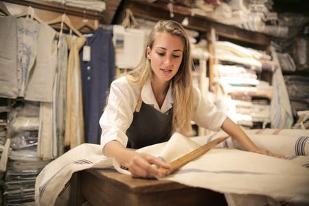 Artisan at work with fabrics
