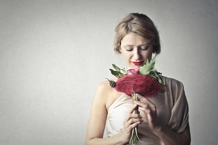 Portrait of a woman with a bouquet Фото со стока