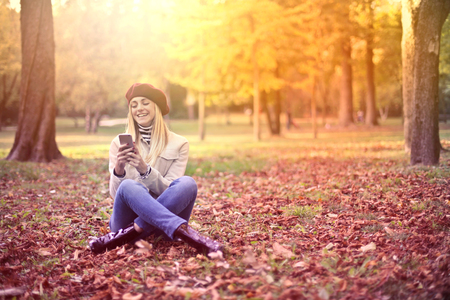 Girl with a smartphone in a natural context