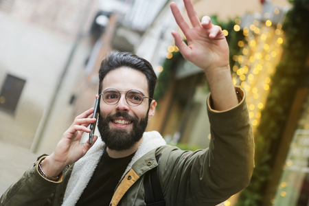 Man making a hand while talking at the phone Stock fotó