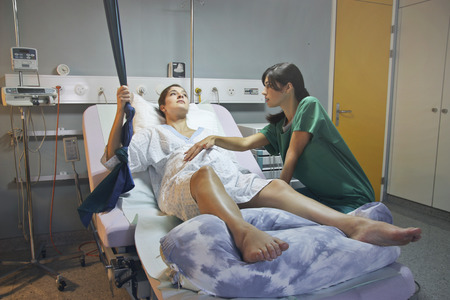 Pregnant woman in a hospital with a gynecologist Standard-Bild