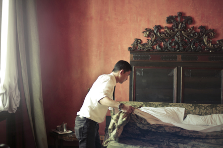 Manservant at work in a hotel Imagens