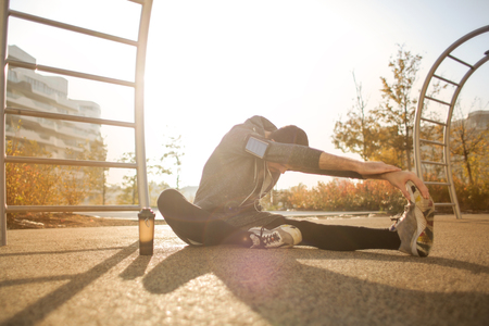 Guy doing some stretching in a park Stock Photo