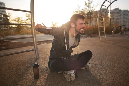Guy doing some stretching in a park Stok Fotoğraf