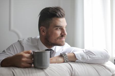 차 한잔과 우아한 남자 스톡 콘텐츠