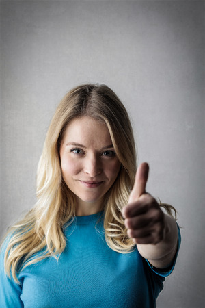 Young woman making the ok gesture