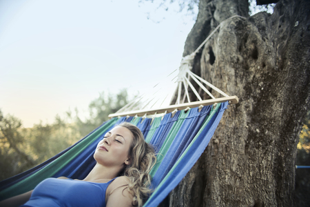Girl relaxing on an hammock Stock Photo