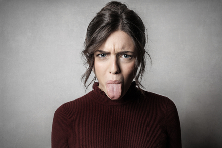Portrait of a girl showing her tongue