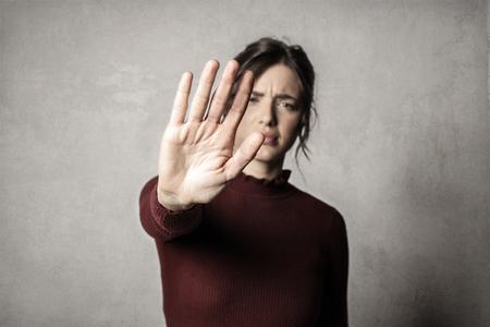 Woman making the stop gesture Standard-Bild