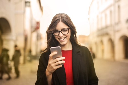 Woman with phone outdoor