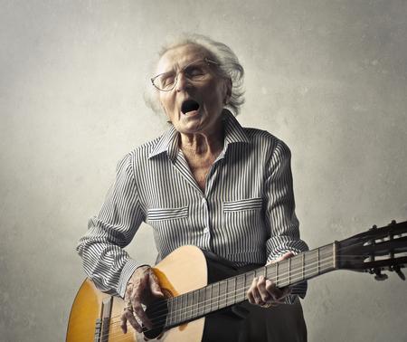 Aged man playing guitar