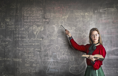 Young professor in front of a blackboard