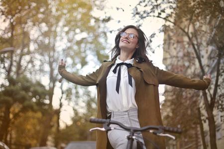 Happy girl on a bike Foto de archivo