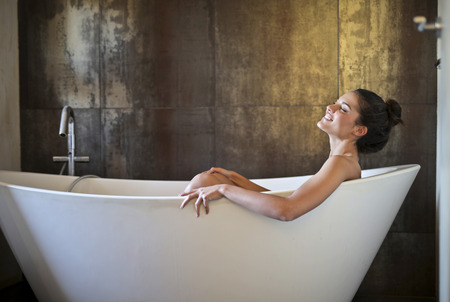 Relaxed girl in a bath