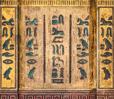 dirty carpet: Egyptian hieroglyphics grunge background on wood texture