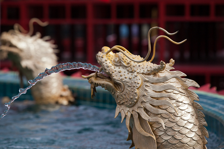 eligion: fountain statue of chinese dragonwater fall chinese style Stock Photo
