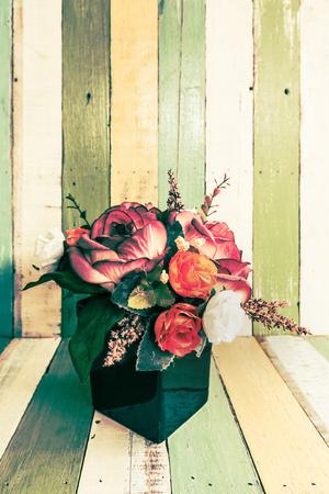 screened: flowers in vase on retro vintage background design
