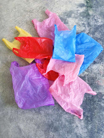 Colorful plastic bag on cement floor Stock Photo