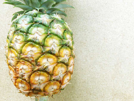 plywood: pineapple isolated on plywood background Stock Photo