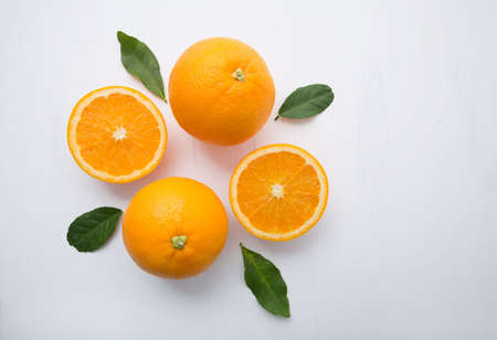 Fresh orange citrus fruit on wooden white background. Top view