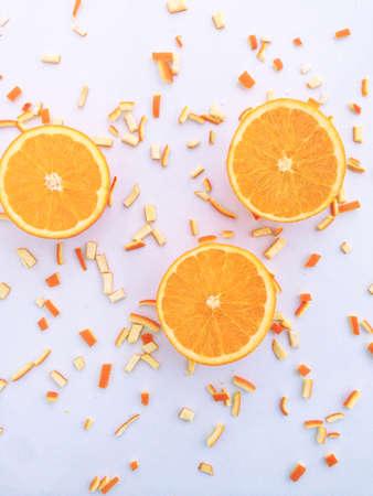 Fresh orange and slices on white background.