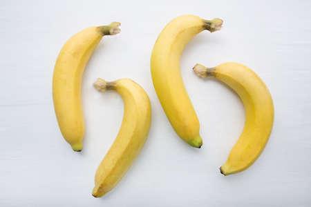 banana skin: Banana on white wooden background.