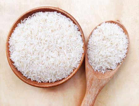 Thai rice on wooden background