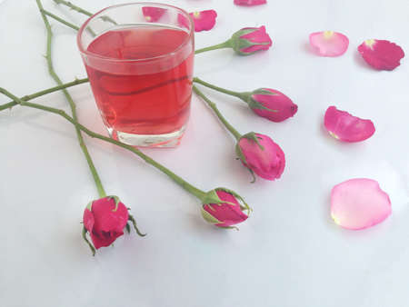 love at first sight: pink rose and sweet drink Stock Photo