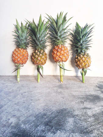 Pineapple isolated on cement floor Stock Photo