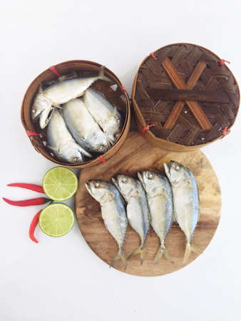 short mackerel on cutting board with fish basket Stock Photo