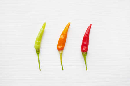 Colorful chili peppers  on white background.