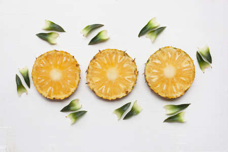 Slices of pineapple with leaf isolated on white background