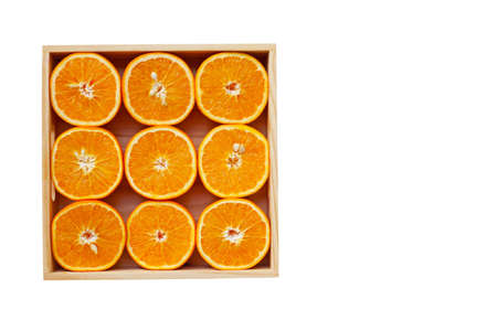 Fresh orange citrus fruit in wooden box isolated on white background.  Top view