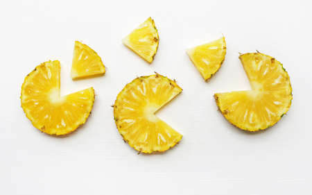 Slices of pineapple isolated on white background.