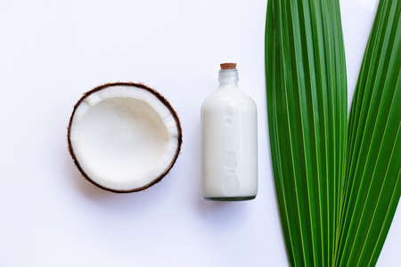 Coconut with coconut milk on white background