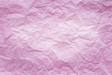 Pink crumpled recycle paper background
