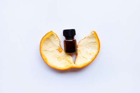 Essential oil of orange on white background.